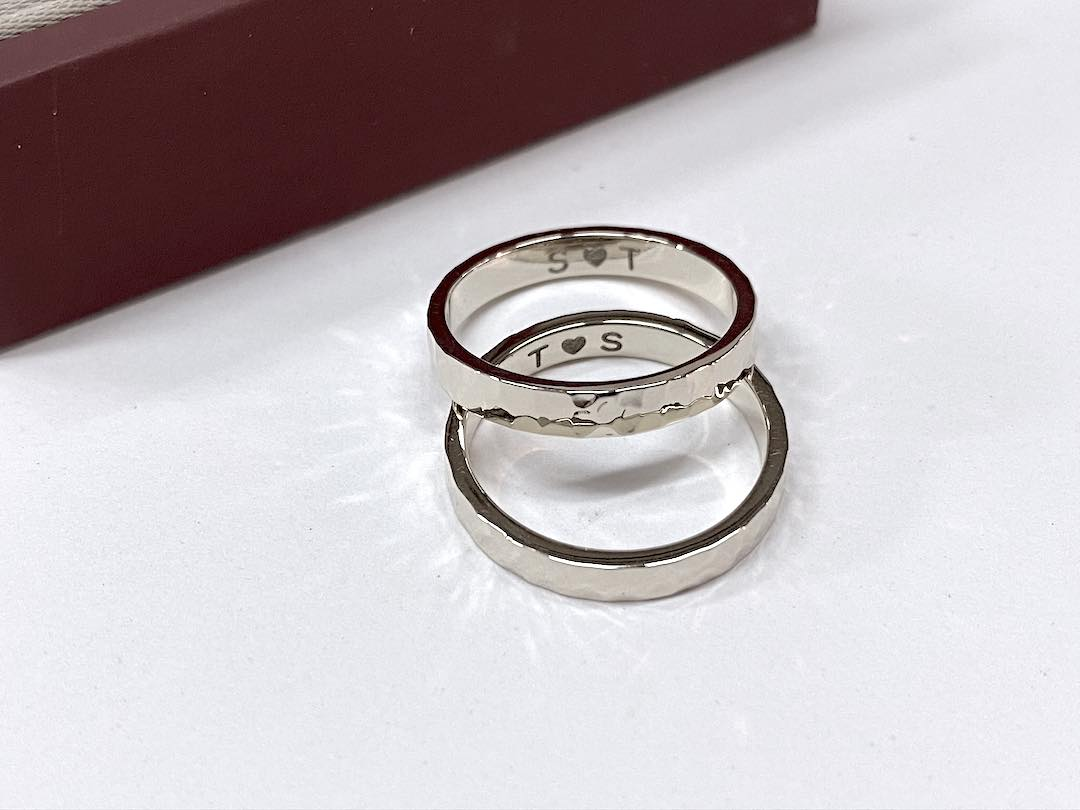 vanilla gold couple diamond band rings on top of each other with name engravings