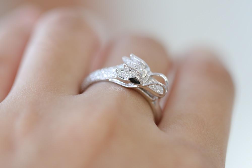 custom dragon diamond ring on hand