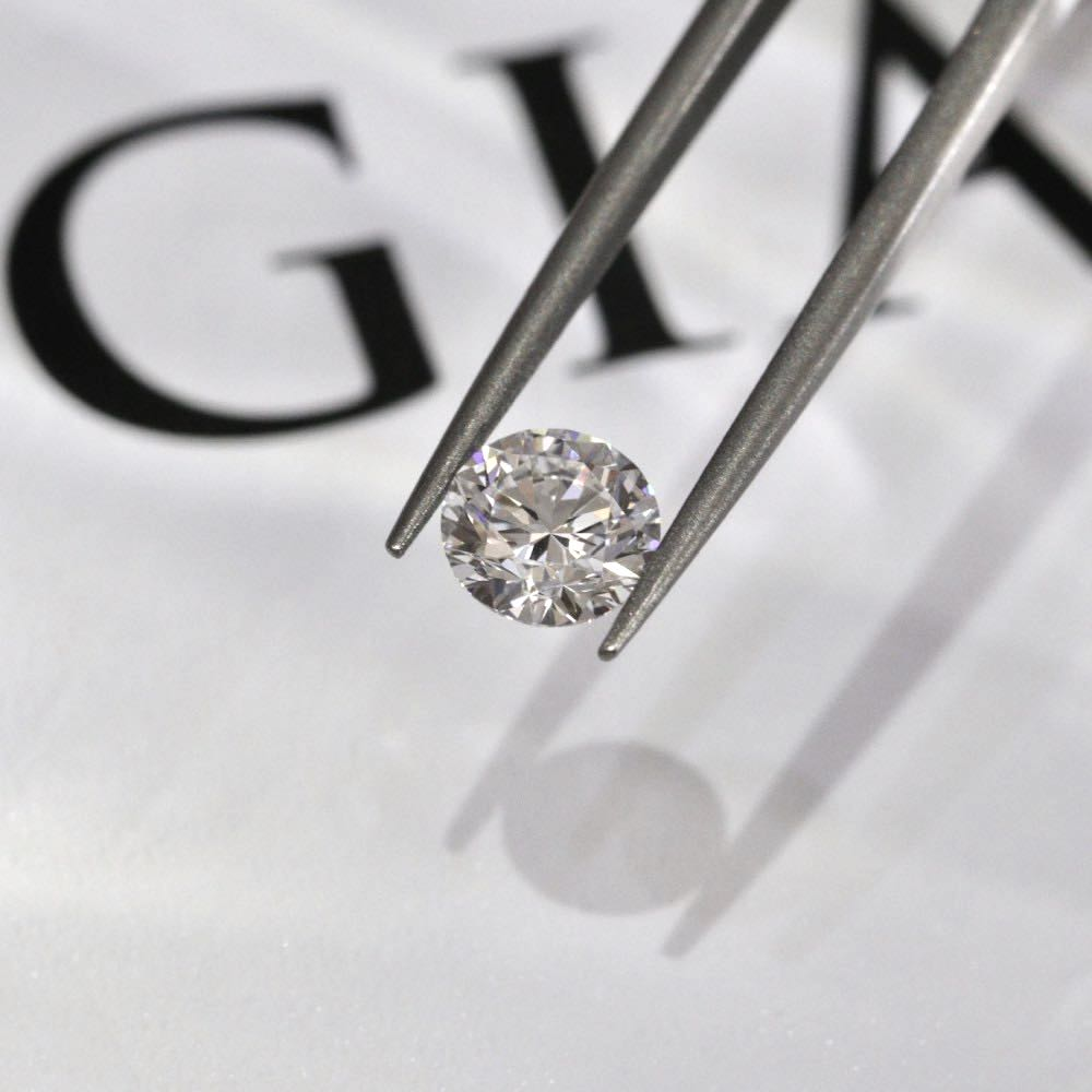 tweezers holding GIA certified diamond