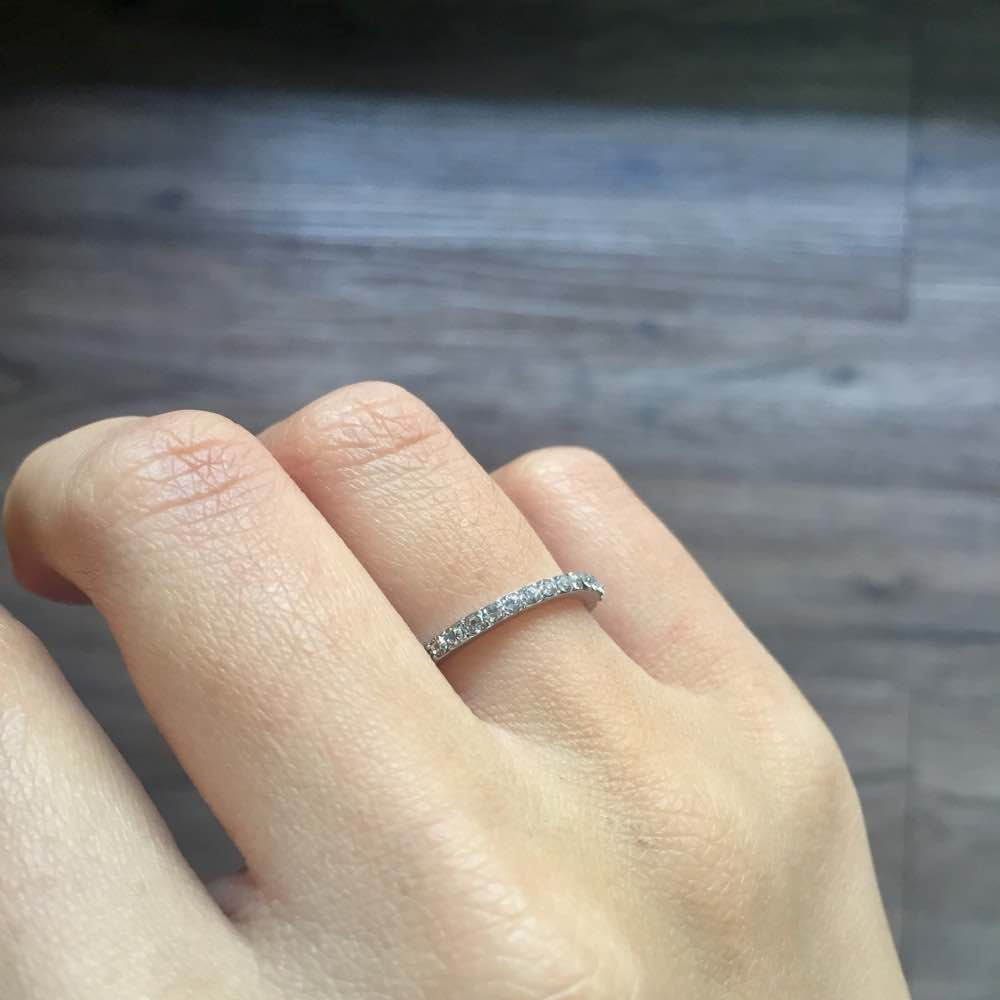 half eternity diamond ring on hand