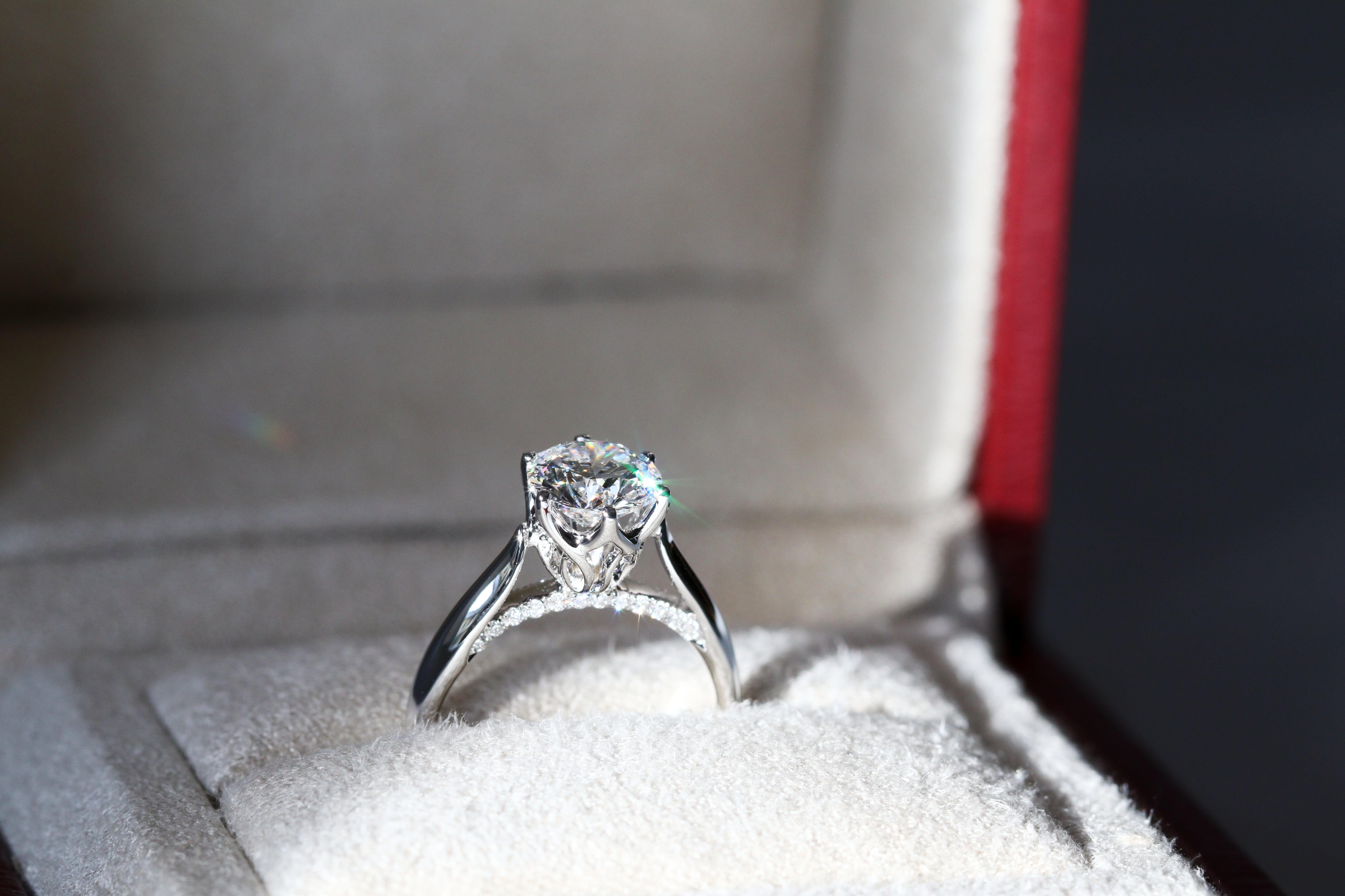 black and white photo of a diamond ring